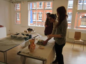 Hannah, Polly and Alice installing exhibition